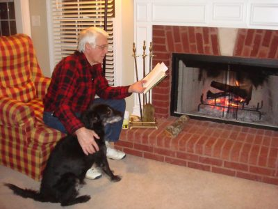 Grandpa sits down with his pup at his side